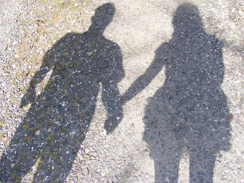 Image of Two Shadows Holding Hands
